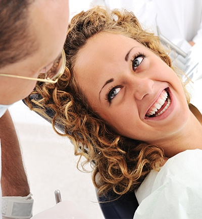 Pretty woman smiling at dentist