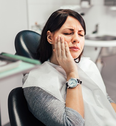 woman wincing in pain