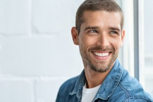 man smiling with healthy gum recontouring aftercare