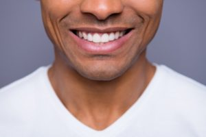 man smiling after bone graft in Lincoln