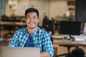 man smiling after deciding between porcelain veneers and composite veneers